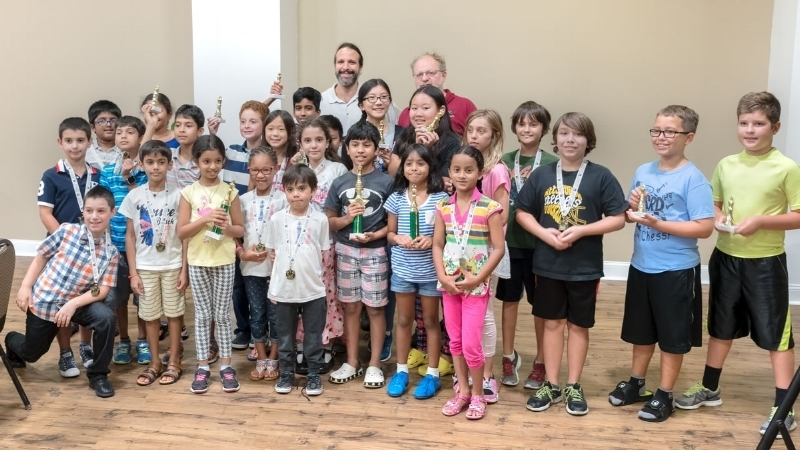 Players in the Scholastic Section of OCG/OCA's USCF tournament held at UCF's Student Union Complex on Saturday July 30, 2016, along with OCG's Tournament Director Steven Vigil and OCG Founder Alex Zelner (Rear).