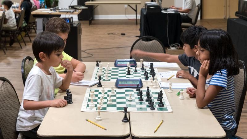Round 4, Board 2, Colton T. (L) vs Kareena S.(R) (Front) &Board 1 Steven H. (L) vs Neel S. (R) (Rear)
