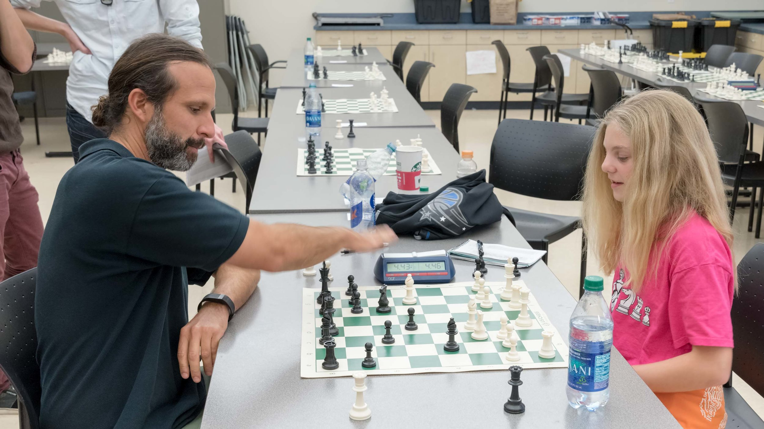 Zoe Zelner (R) (1836)and her long-time chess coach and mentor steven vigil (L) (1905) having some fun with blitz games after the tournament!