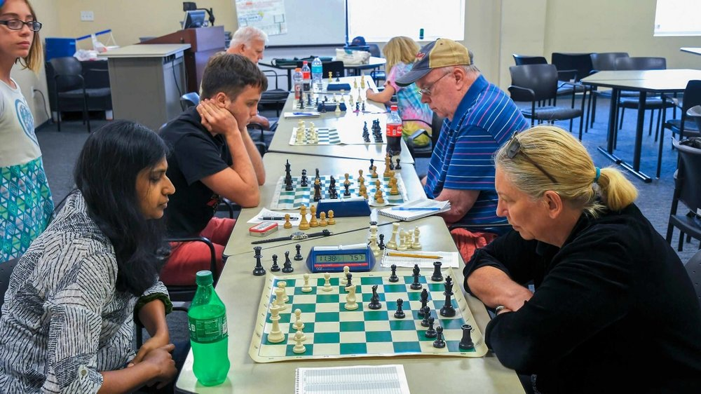Round 4, Board 1,Bharathi Thangavelo (Unr.) (L) vs Dr. Catherine Zelner (1661) (R) in the OCG Quick Tournament held on July 15, 2017 hosted by UCF's Chess Club.