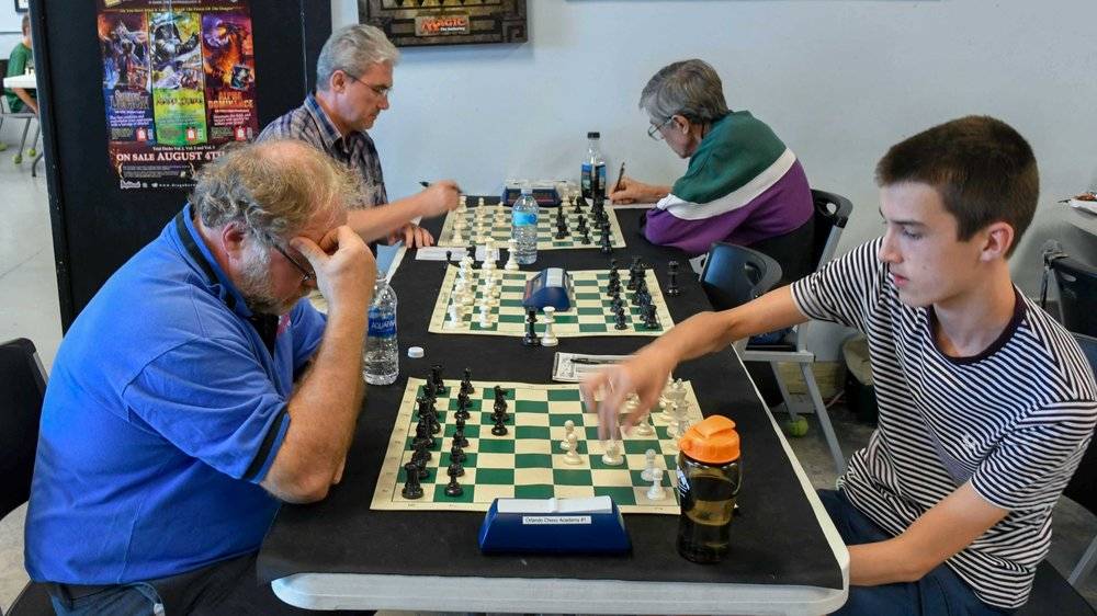 Board 1, Round 5,FM Alex Zelner (Q-1934) (L) vs Theo Slade (Q-1912)(R) where their game ended in a draw.