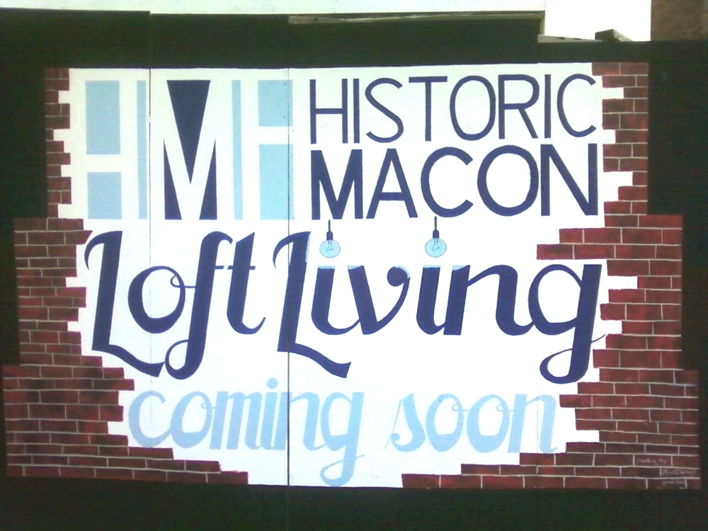 Temporary sign painted on a construction wall on Cherry St. 2012.