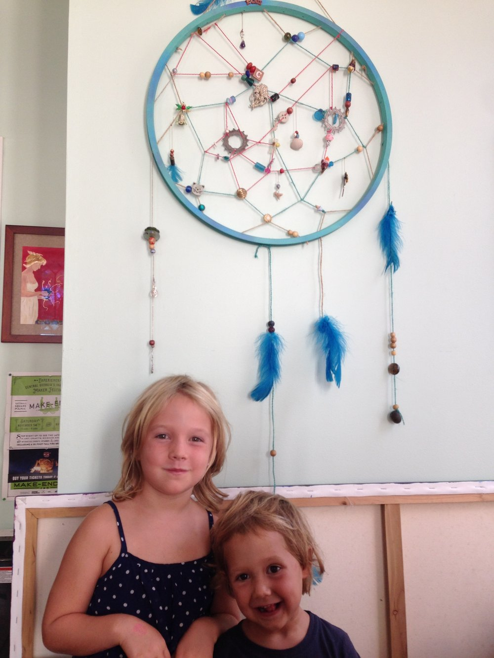 These little angels assisted the artist in the creation of their very own dream catcher!