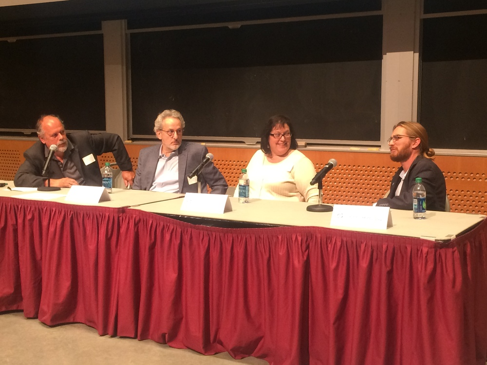 John Carroll, Don Ingber, Peggy Guzzie-Peck, and Chris Hinojosa (left to right) discuss organs-on-chips.