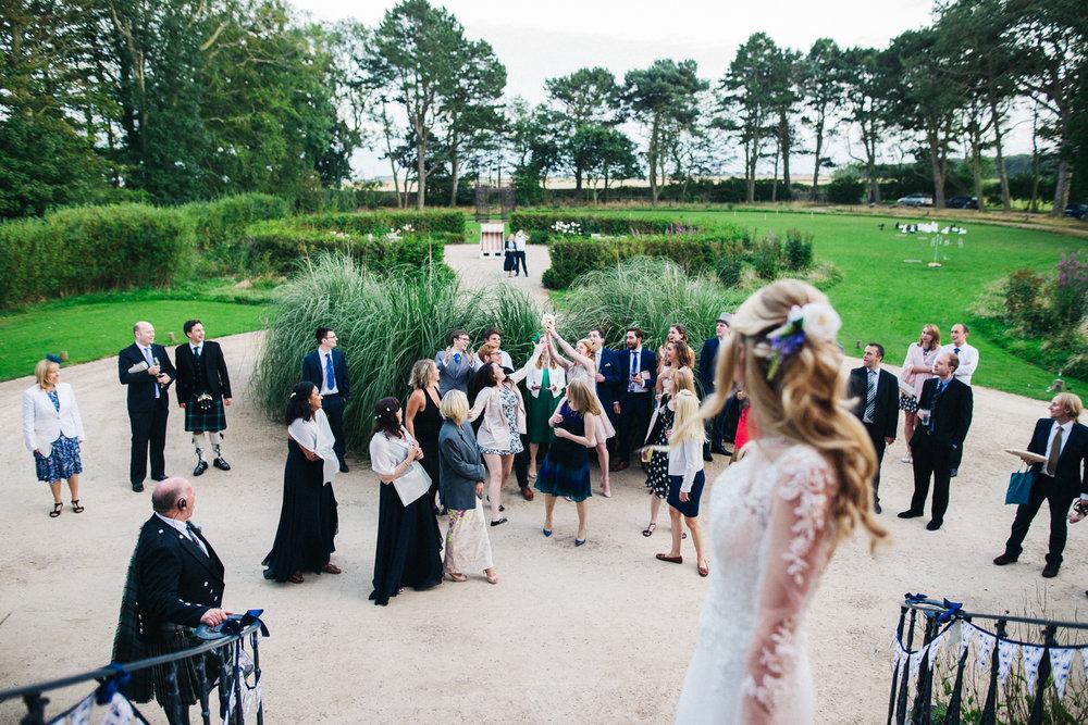 newton-hall-northumberland-wedding-cycling-bike-theme-beach-0111.jpg