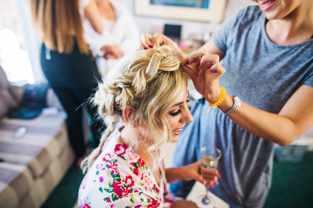a bride has her hair adjusted. creative wedding photography north yorkshire teesside north east + stop motion wedding films uk