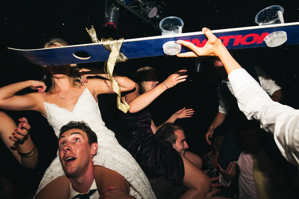 a chaotic dancefloor shot with a shot ski. creative wedding photography north yorkshire teesside north east + stop motion wedding films uk