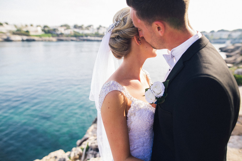 a bride and groom kiss by the sea. creative wedding photography north yorkshire teesside north east + stop motion wedding films uk