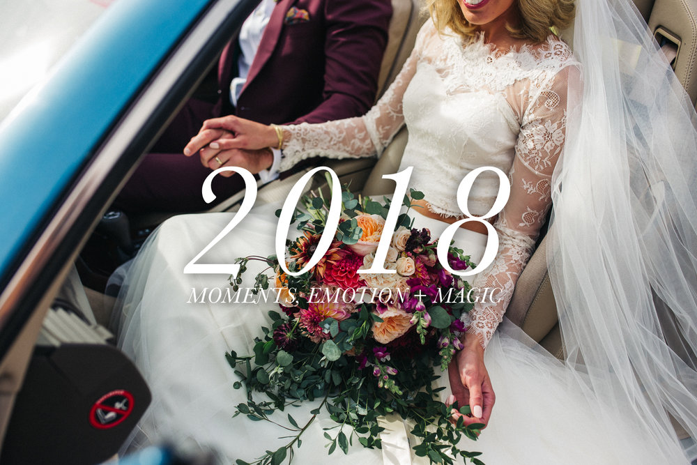 man and woman sitting in a car, she has a wedding bouquet on her lap