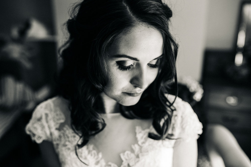 a black and white close portrait of a bride in her dress. village hall wedding venue north yorkshire northallerton. stop motion wedding films videos uk