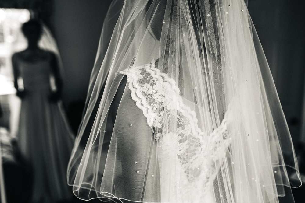 a close up detail shot of a bride in her lace dress with her veil. wedding at aldby park york north yorkshire. stop motion wedding films videos uk