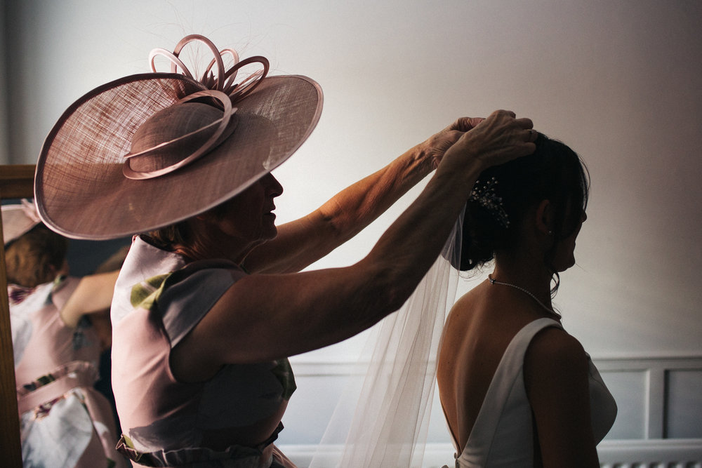 a bride has her veil fitted by her mum. wedding at the talbot and york house in malton north yorkshire. stop motion wedding films videos uk