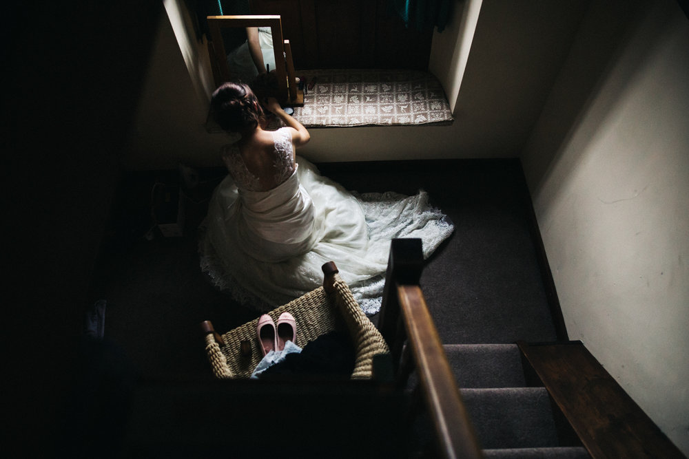 bride putting her make up on in the window light. lake district wedding photographer. stop motion wedding films videos uk