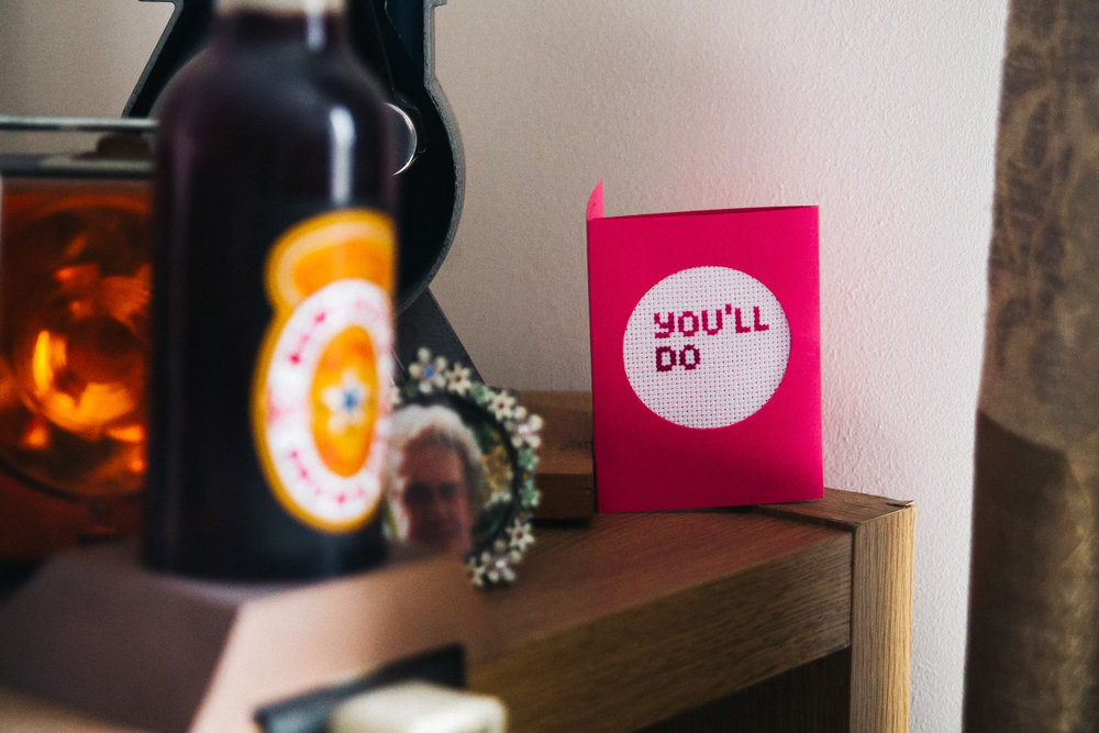 "clutter on a sideboard with a card that reads ""You'll do"". knights templar london wedding. stop motion wedding films videos uk"
