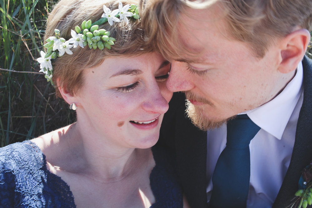 a close shot of a bride and groom with their heads close. scotland outdoor humanist beach wedding. stop motion wedding films uk