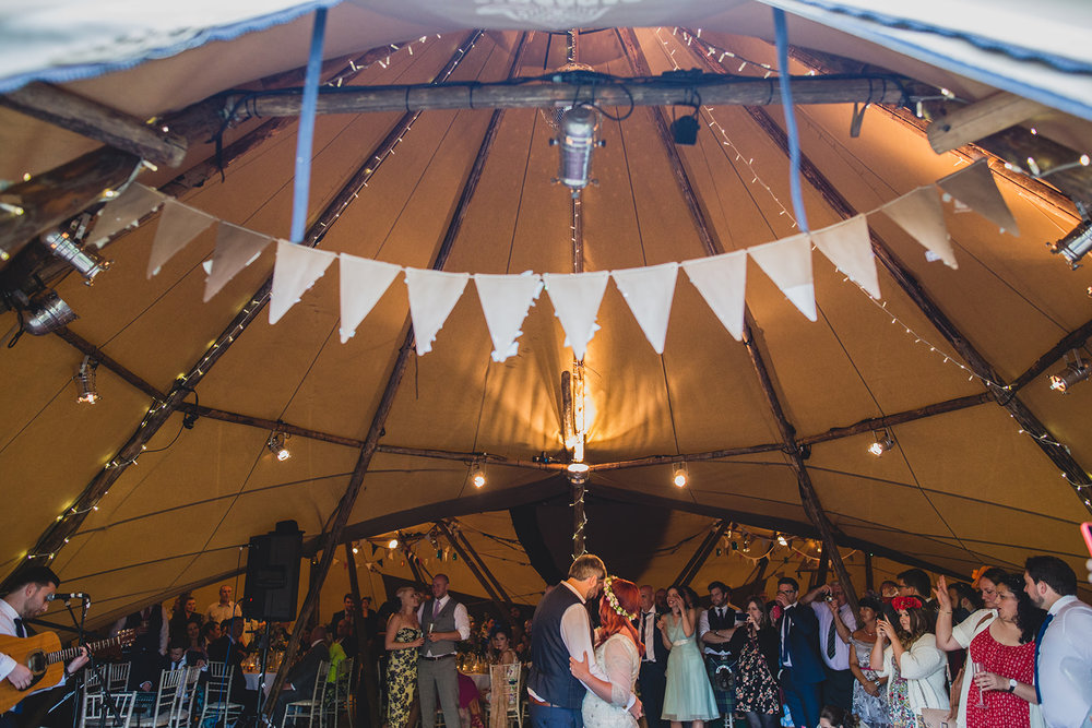 a bride and groom do their first dance in a tipi. camp katur wedding north yorkshire tipi wedding venue glamping. stop motion wedding films uk