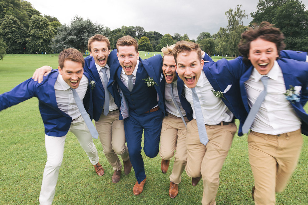 the groom and groomsmen run towards the camera. newburgh priory north yorkshire outdoor marquee wedding. stop motion wedding films uk