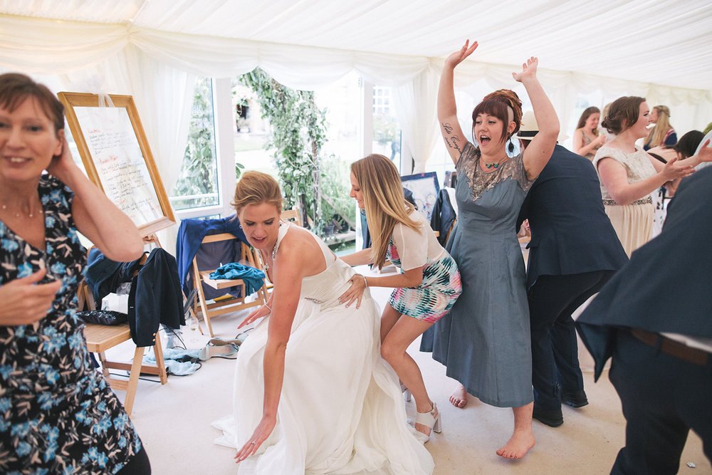 a bride dances with her friends during the evening reception. newburgh priory north yorkshire outdoor marquee wedding. stop motion wedding films uk