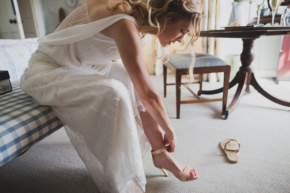 a bride does her shoes up. underlay grange marquee wedding lake district. stop motion wedding films uk