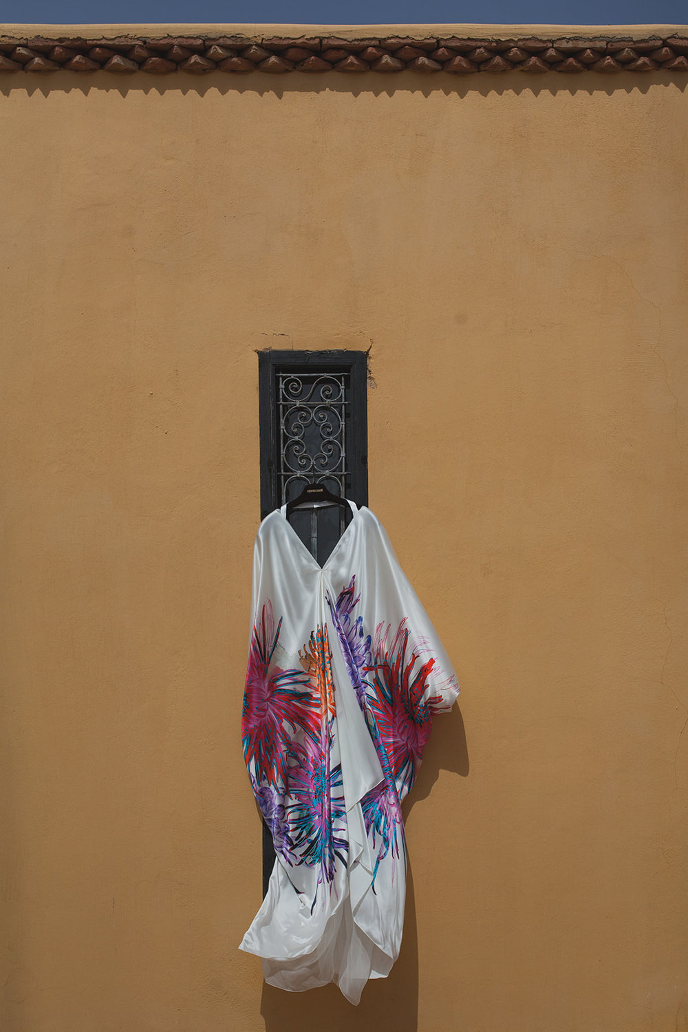a dress hangs and blows in the breeze. fawakay villas marrakech wedding morrocco wedding photography. stop motion wedding films uk