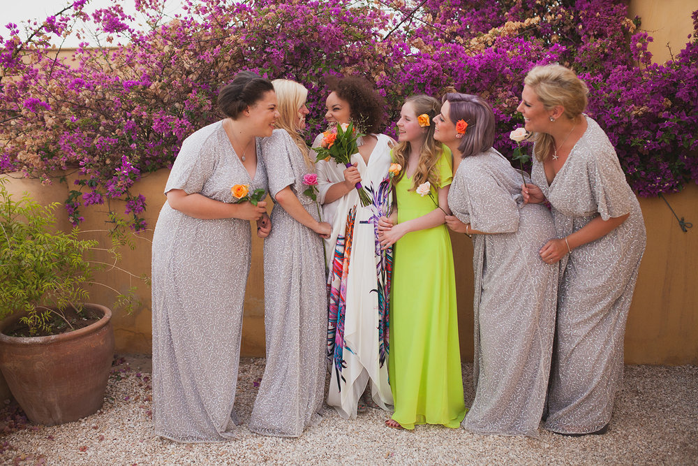 a bride and her bridesmaids laugh together. fawakay villas marrakech wedding morrocco wedding photography. stop motion wedding films uk