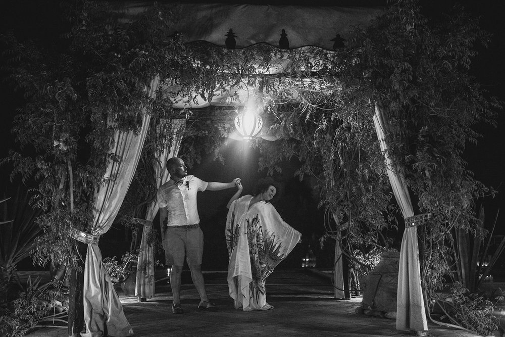 an evening portrait shot of a bride and groom under their ceremony canopy. fawakay villas marrakech wedding morrocco wedding photography. stop motion wedding films uk