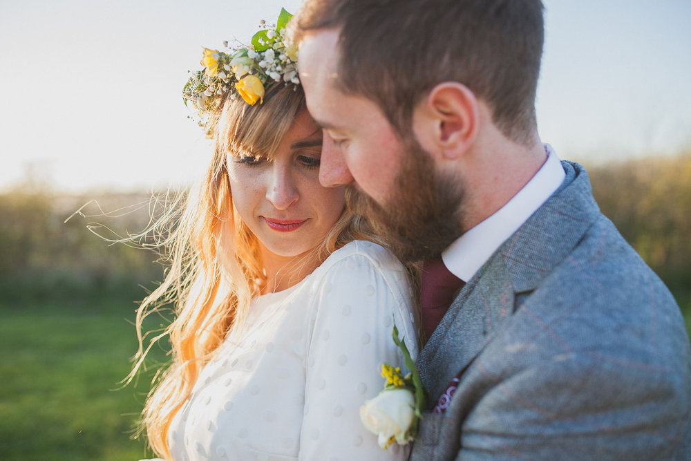 a close shot of a bride and groom close in golden light. york maze barn wedding, york city, north yorkshire wedding photographer. stop motion wedding films UK.