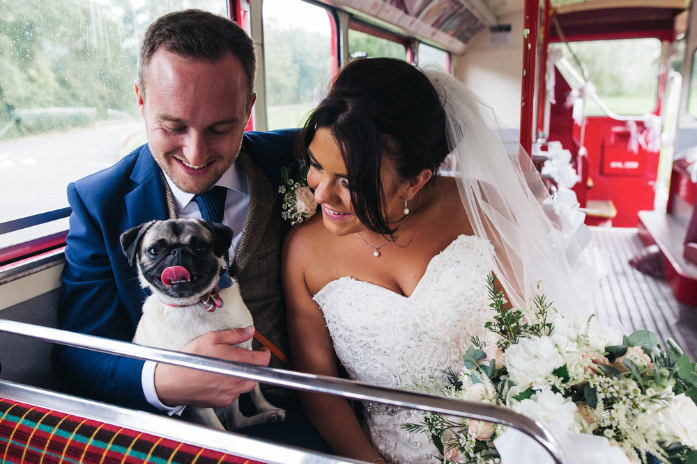 a bride and groom both look to their dog and smile. stop motion wedding films and wedding photography whinstone view, great ayton, north yorkshire