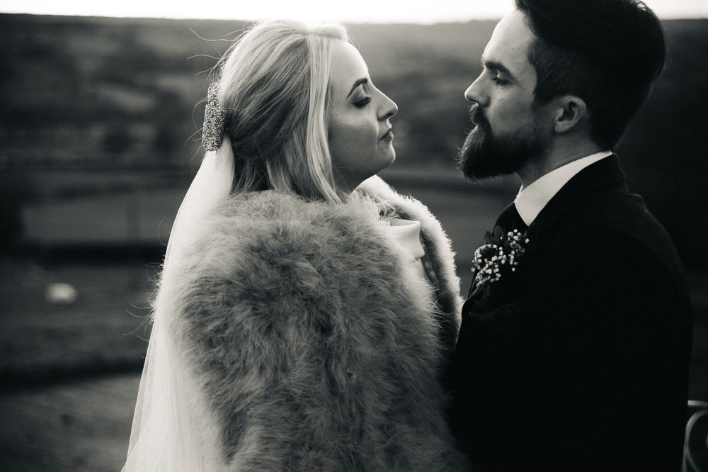 a black and white shot of a bride and groom looking at each other. intimate winter wedding north east wedding photographer, stop motion wedding films uk