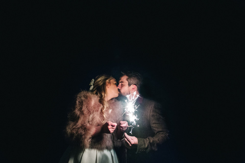 a nighttime shot of the bride and groom illuminated only by sparklers. intimate winter wedding north east wedding photographer, stop motion wedding films uk