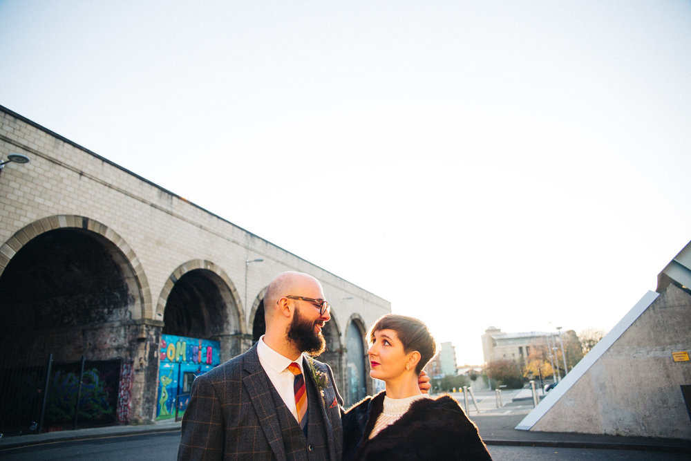 a bride and groom look at each other, a viaduct in the background. st marys heritage centre wedding gateshead newcastle. wedding photography north east stop motion films uk