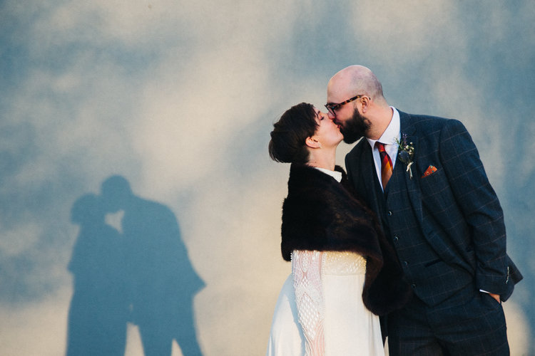 a bride and groom kiss, their shadow shows a kissing couple too. st marys heritage centre wedding gateshead newcastle. wedding photography north east stop motion films uk