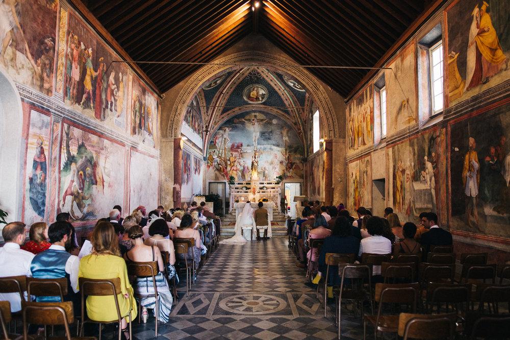 a very decorated and beautiful italian church interior. destination wedding hotel monte rosa chiavari italy. stop motion wedding films uk