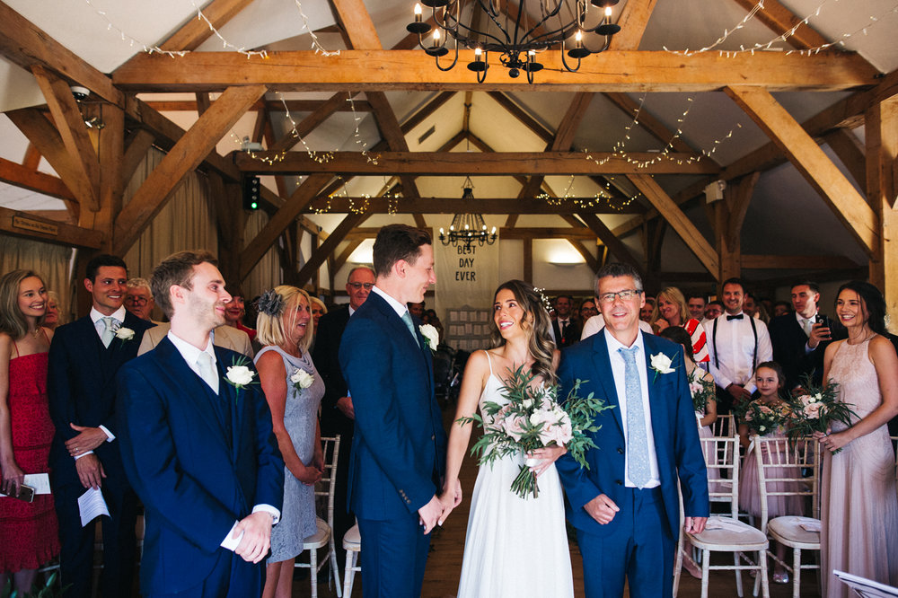 a bride and groom meet at the end of the aisle. sandhole oak barn wedding congleton cheshire. stop motion wedding films uk