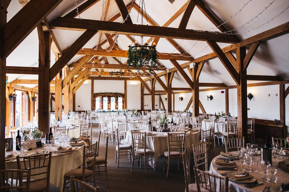 a barn set with tables for a wedding. sandhole oak barn wedding congleton cheshire. stop motion wedding films uk