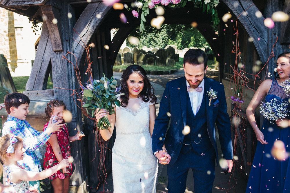 a confetti shot of the bride and groom. diy village hall wedding venues north yorkshire northallerton. stop motion wedding films uk