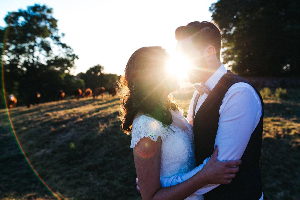 a golden hour sunset shot of the bride and groom. diy village hall wedding venues north yorkshire northallerton. stop motion wedding films uk
