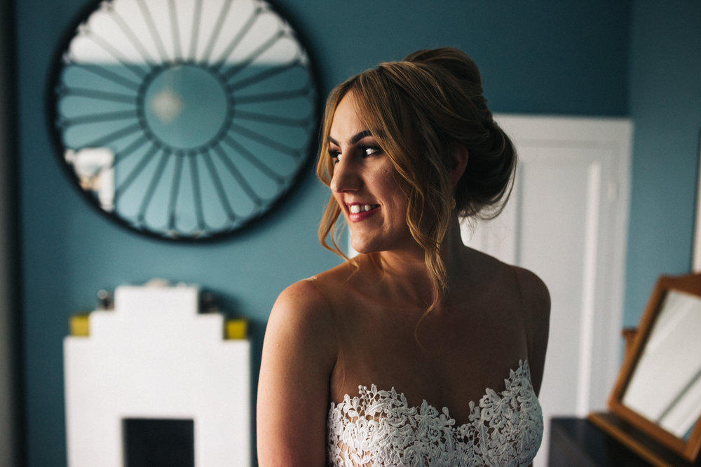 a portrait of the bride in her dress. ormesby hall wedding middlesbrough teesside wedding photography and stop motion wedding films uk