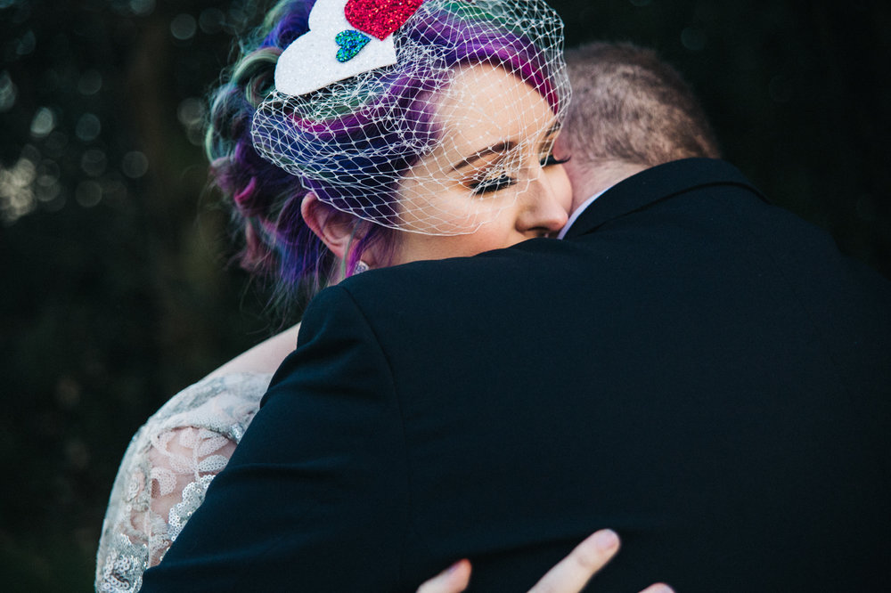a bride snuggles into the groom. white hart inn derby wedding photographer and stop motion wedding films teesside uk