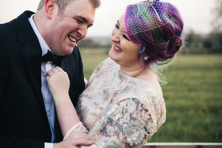 the bride and groom laugh together. white hart inn derby wedding photographer and stop motion wedding films teesside uk
