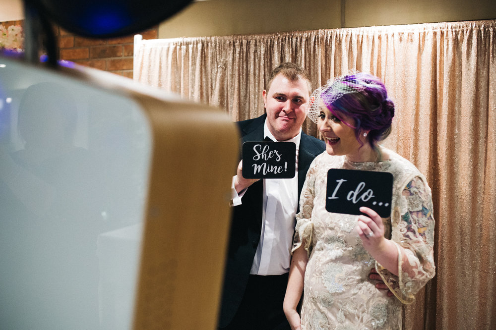 the bride and groom stand in the photo booth together. white hart inn derby wedding photographer and stop motion wedding films teesside uk