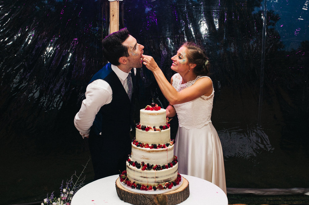a bride feeds a groom cake. aldby park wedding york north yorkshire teesside photography stop motion wedding films uk