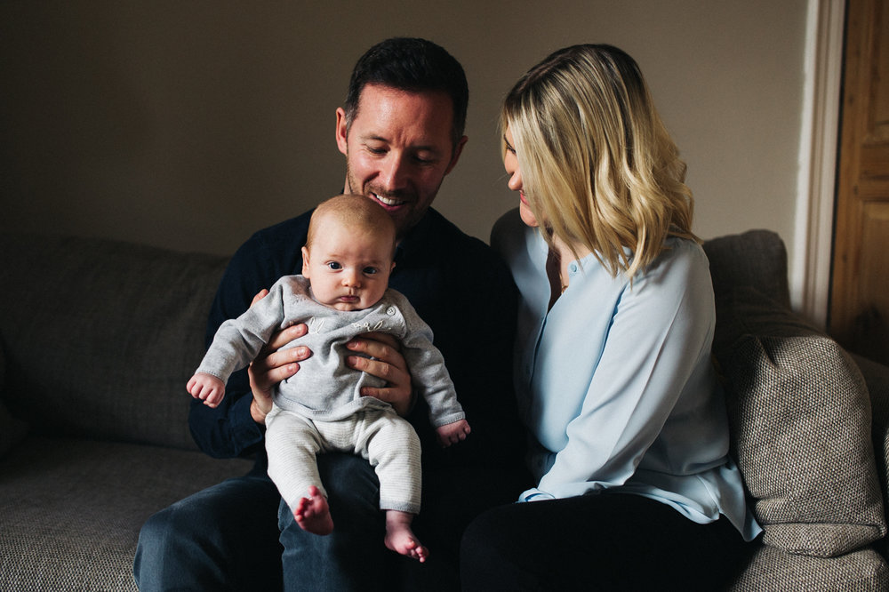 a family photo of a mum, dad and their baby son. creative and relaxed family photography at home teesside middlesbrough stockton north east north yorkshire. stop motion wedding films uk