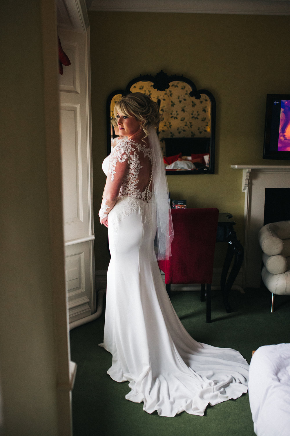 a portrait shot of the bride in her wedding dress looking out of the window. cleveland tontine wedding teesside north yorkshire - relaxed and creative wedding photographer