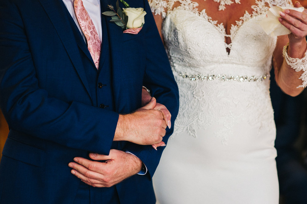 a close shot of the bride and groom holding hands. cleveland tontine wedding teesside north yorkshire - relaxed and creative wedding photographer