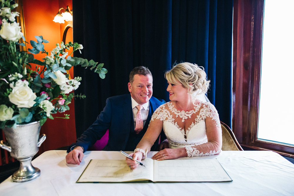 the bride andgroom sign the register. cleveland tontine wedding teesside north yorkshire - relaxed and creative wedding photographer