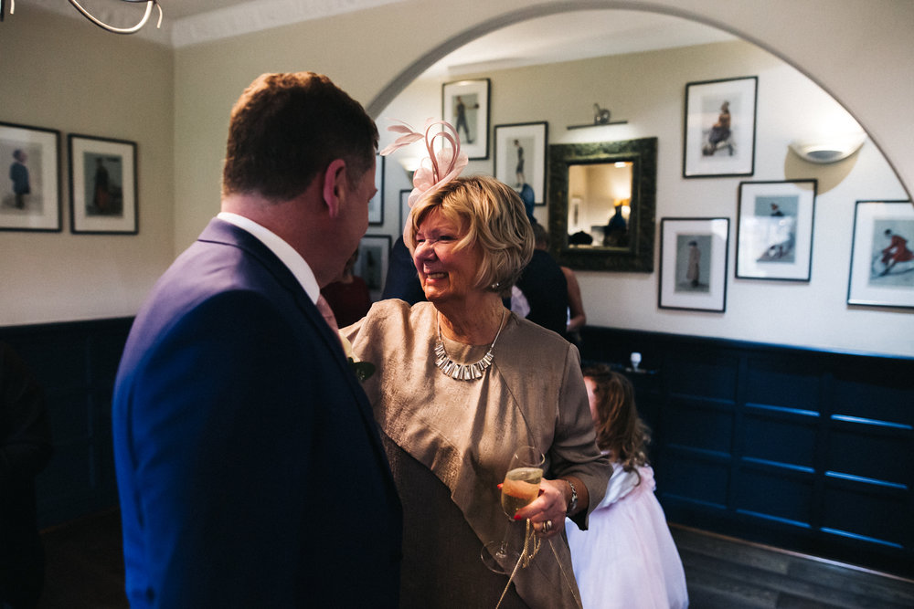 the groom greets a wedding guest after the ceremony. cleveland tontine wedding teesside north yorkshire - relaxed and creative wedding photographer