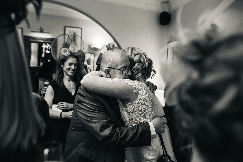 the bride hugs her dad after the ceremony. cleveland tontine wedding teesside north yorkshire - relaxed and creative wedding photographer