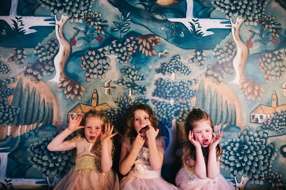 three young girls pul funny faces to the camera. cleveland tontine wedding teesside north yorkshire - relaxed and creative wedding photographer