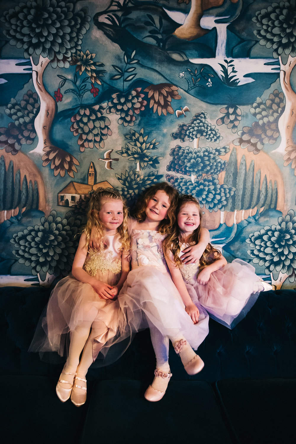 three young girls sit together and hug. cleveland tontine wedding teesside north yorkshire - relaxed and creative wedding photographer
